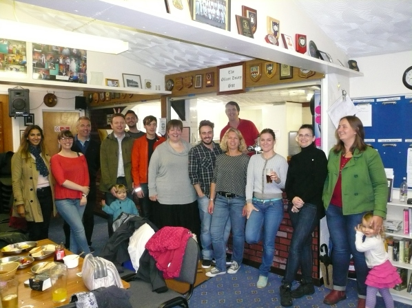 A group photo inside St. Fagan's Bowls Club